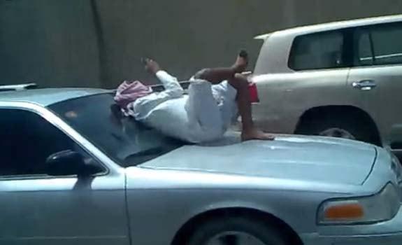 SaudiManTextingCarHoodFreewaystack2