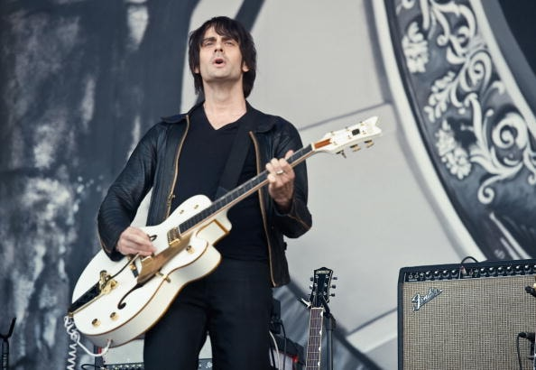 GLASTONBURY, ENGLAND - JUNE 26:  Dean Fertita from 'The Dead Weather' performs live on the Pyramid Stage during Day 3 of the Glastonbury Festival on June 26, 2010 in Glastonbury, England. This year sees the 40th anniversary of the festival which was started by a dairy farmer, Michael Evis in 1970 and has grown into the largest music festival in Europe.  (Photo by Ian Gavan/Getty Images)