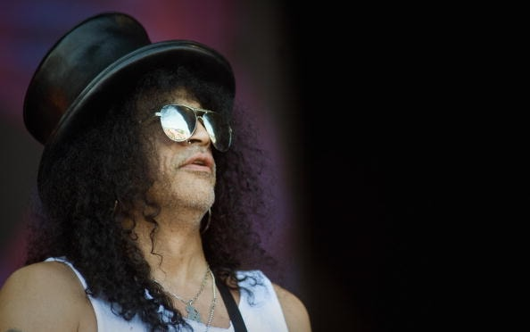 GLASTONBURY, ENGLAND - JUNE 27:  Slash performs on The Pyramid Stage during Day 4 of the Glastonbury Festival on June 27, 2010 in Glastonbury, England. This year sees the 40th anniversary of the festival which was started by a dairy farmer, Michael Evis in 1970 and has grown into the largest music festival in Europe.  (Photo by Ian Gavan/Getty Images)