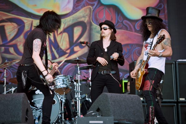 GLASTONBURY, ENGLAND - JUNE 27:  Myles Kennedy (C) and Slash (R) perform on The Pyramid Stage during Day 4 of the Glastonbury Festival on June 27, 2010 in Glastonbury, England. This year sees the 40th anniversary of the festival which was started by a dairy farmer, Michael Evis in 1970 and has grown into the largest music festival in Europe.  (Photo by Ian Gavan/Getty Images)