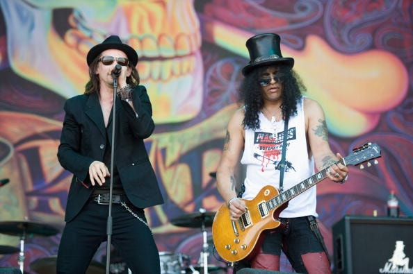 GLASTONBURY, ENGLAND - JUNE 27:  Myles Kennedy and Slash perform on The Pyramid Stage during Day 4 of the Glastonbury Festival on June 27, 2010 in Glastonbury, England. This year sees the 40th anniversary of the festival which was started by a dairy farmer, Michael Evis in 1970 and has grown into the largest music festival in Europe.  (Photo by Ian Gavan/Getty Images)