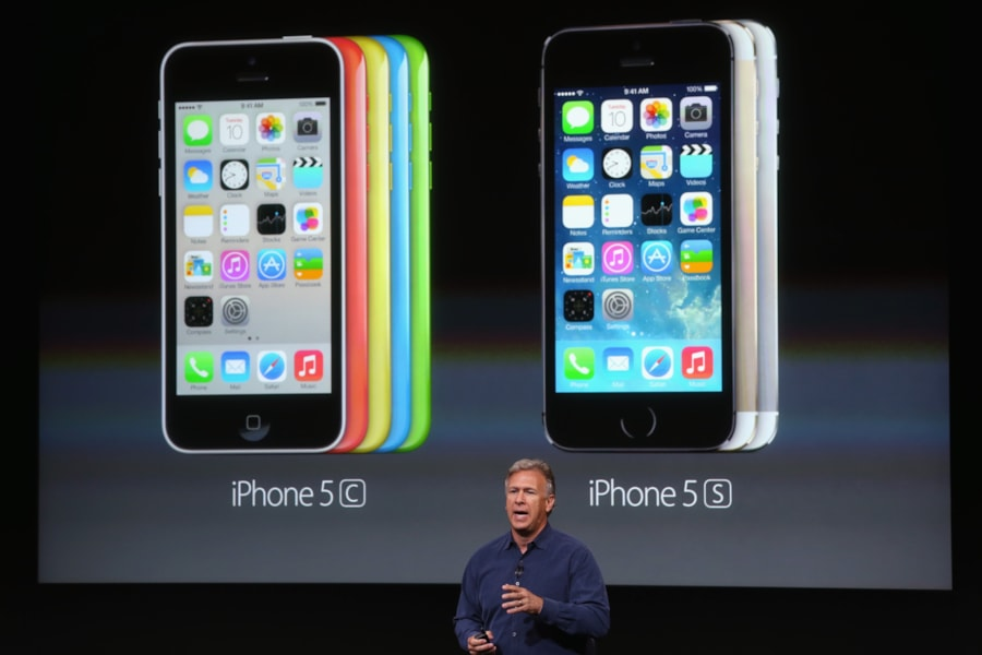 CUPERTINO, CA - SEPTEMBER 10:  Apple Senior Vice President of Worldwide Marketing at Phil Schiller speaks about pricing for the new iPhone during an Apple product announcement at the Apple campus on September 10, 2013 in Cupertino, California. The company launched two new iPhone models that will run iOS 7. The 5C is made from a hard-coated polycarbonate and comes in five colors. The 5S comes in three colors, features a fingerprint sensor, has an upgraded camera, and contains an A7 chip.  (Photo by Justin Sullivan/Getty Images)
