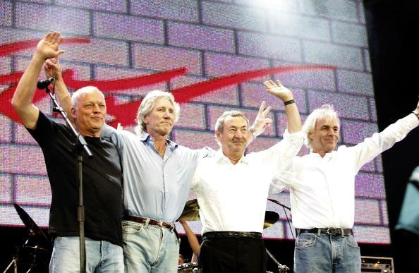 """LONDON - JULY 02:  (L to R)  David Gilmour, Roger Waters, Nick Mason and Rick Wright from the band Pink Floyd on stage at """"Live 8 London"""" in Hyde Park on July 2, 2005 in London, England.  The free concert is one of ten simultaneous international gigs including Philadelphia, Berlin, Rome, Paris, Barrie, Tokyo, Cornwall, Moscow and Johannesburg. The concerts precede the G8 summit (July 6-8) to raising awareness for MAKEpovertyHISTORY.  (Photo by MJ Kim/Getty Images)"""