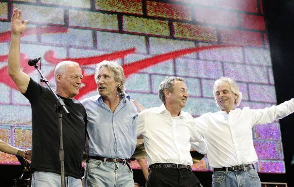 """LONDON - JULY 2: (L-R)  David Gilmour, Roger Waters, Nick Mason and Rick Wright from the band Pink Floyd on stage at """"Live 8 London"""" in Hyde Park on July 2, 2005 in London, England.  The free concert is one of ten simultaneous international gigs including Philadelphia, Berlin, Rome, Paris, Barrie, Tokyo, Cornwall, Moscow and Johannesburg. The concerts precede the G8 summit (July 6-8) to raising awareness for MAKEpovertyHISTORY.  (Photo by MJ Kim/Getty Images)"""