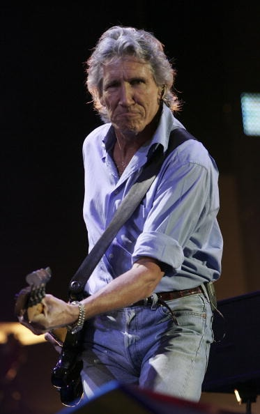 """LONDON - JULY 02:  Roger Waters from the band Pink Floyd performs on stage at """"Live 8 London"""" in Hyde Park on July 2, 2005 in London, England.  The free concert is one of ten simultaneous international gigs including Philadelphia, Berlin, Rome, Paris, Barrie, Tokyo, Cornwall, Moscow and Johannesburg. The concerts precede the G8 summit (July 6-8) to raising awareness for MAKEpovertyHISTORY.  (Photo by MJ Kim/Getty Images)"""