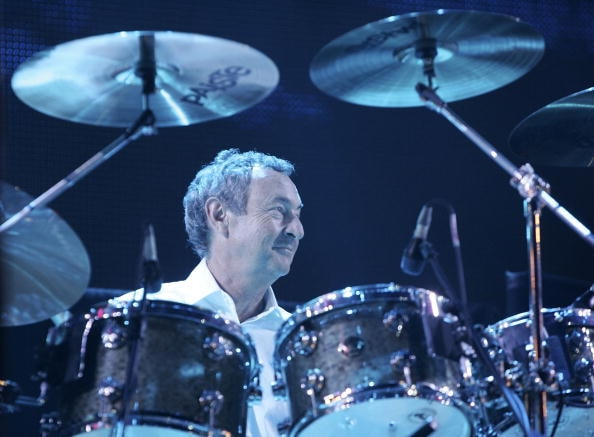 """LONDON - JULY 02:  Nick Mason from the band Pink Floyd performs on stage at """"Live 8 London"""" in Hyde Park on July 2, 2005 in London, England.  The free concert is one of ten simultaneous international gigs including Philadelphia, Berlin, Rome, Paris, Barrie, Tokyo, Cornwall, Moscow and Johannesburg. The concerts precede the G8 summit (July 6-8) to raising awareness for MAKEpovertyHISTORY.  (Photo by MJ Kim/Getty Images)"""