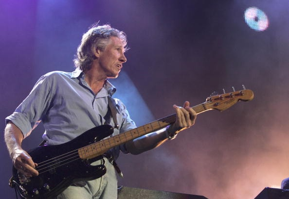 """LONDON - JULY 02:  Roger Waters from Pink Floyd performs on stage at """"Live 8 London"""" in Hyde Park on July 2, 2005 in London, England.  The free concert is one of ten simultaneous international gigs including Philadelphia, Berlin, Rome, Paris, Barrie, Tokyo, Cornwall, Moscow and Johannesburg.  The concerts precede the G8 summit (July 6-8) to raising awareness for MAKEpovertyHISTORY.  (Photo by Jo Hale/Getty Images)"""