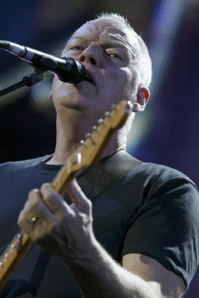 """LONDON - JULY 02:  Dave Gilmour of Pink Floyd performs on stage at """"Live 8 London"""" in Hyde Park on July 2, 2005 in London, England.  The free concert is one of ten simultaneous international gigs including Philadelphia, Berlin, Rome, Paris, Barrie, Tokyo, Cornwall, Moscow and Johannesburg.  The concerts precede the G8 summit (July 6-8) to raising awareness for MAKEpovertyHISTORY.  (Photo by Jo Hale/Getty Images)"""