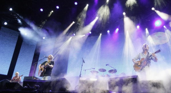 """LONDON - JULY 02:  (L to R) Musicians David Gilmour and Roger Waters from the band Pink Floyd perform on stage at """"Live 8 London"""" in Hyde Park on July 2, 2005 in London, England.  The free concert is one of ten simultaneous international gigs including Philadelphia, Berlin, Rome, Paris, Barrie, Tokyo, Cornwall, Moscow and Johannesburg.  The concerts precede the G8 summit (July 6-8) to raising awareness for MAKEpovertyHISTORY.  (Photo by Jo Hale/Getty Images)"""