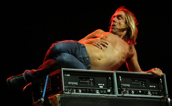 GLASTONBURY, UNITED KINGDOM - JUNE 23:  Iggy Pop performs on the Other Stage at Worthy Farm, Pilton near Glastonbury, on June 23 2007 in Somerset, England. The festival, that was started by dairy farmer Michael Eavis in 1970, has grown into the largest music festival in Europe. This year's festival is the biggest yet and will have headline acts including The Who, The Arctic Monkeys and The Killers.  (Photo by Matt Cardy/Getty Images)