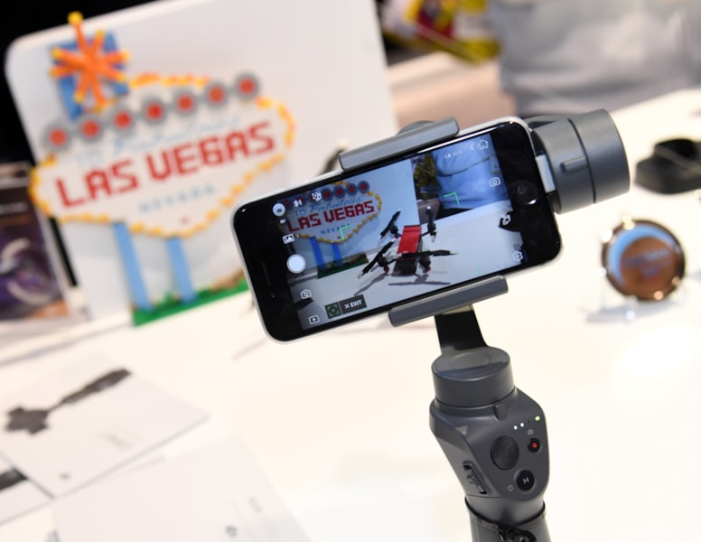 LAS VEGAS, NV - JANUARY 11:  DJI's Osmo Mobile 2 handheld smartphone gimbal is displayed at the DJI booth during CES 2018 at the Las Vegas Convention Center on January 11, 2018 in Las Vegas, Nevada. The Osmo Mobile 2 uses built-in sensors and a brushless motor to stabilize a user's smartphone to allow for time-lapse video, dolly zoom effects and panoramic shots. CES, the world's largest annual consumer technology trade show, runs through January 12 and features about 3,900 exhibitors showing off their latest products and services to more than 170,000 attendees.  (Photo by Ethan Miller/Getty Images)